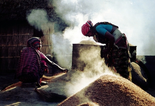 """WORKING WOMEN in rice mill"" is the title of the photo of two Bangladeshi women processing rice in a locally-made oven. The photo won 3rd prize in the amateur category of the FAO's International Year of Rice Global Photography Contest: ""Rice Is Life."" (Photo: Md. Rashid Un Nabi of Bangladesh)"