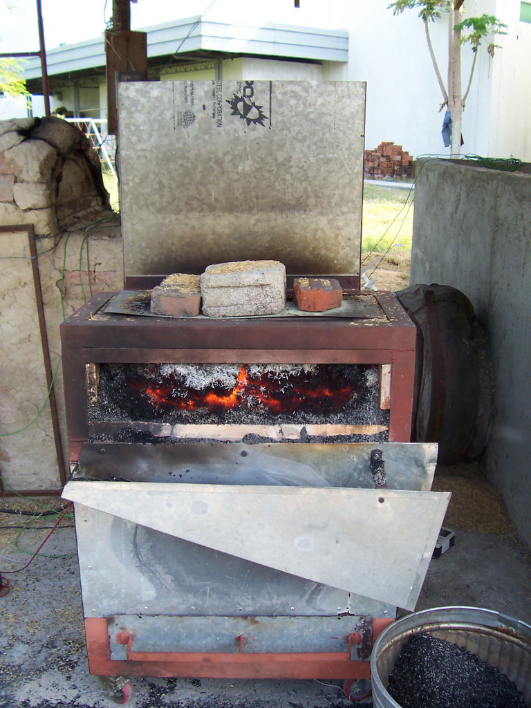 This modified rice husk furnace, developed at IRRI, produces biochar as a by-product of the paddy drying process. (Photo: Dr. Martin Gummert, IRRI)