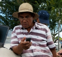 A farmer in Laguna Province pretests the mobile phone service to receive fertilizer recommendations. (Photo: Joseph Sandro)