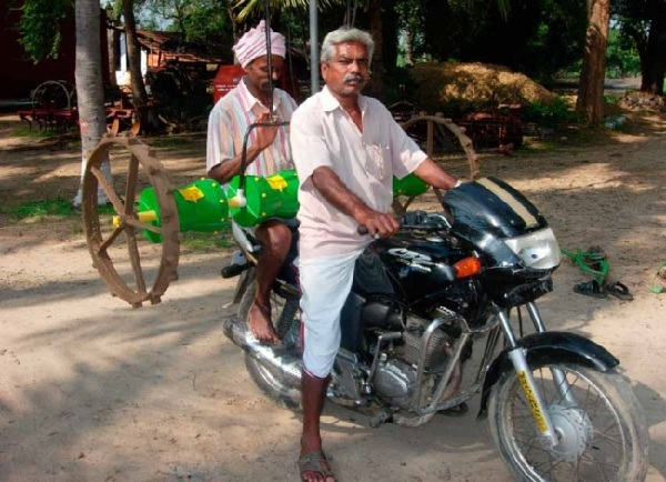 Mr. Chakravathy decided to use a drum seeder this year to sow his new crop. Photo: M.N. Budhar