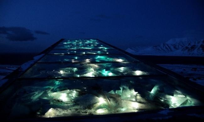 The Vault's illuminated roof against the scenic surroundings. (Photo: Mari Tefre/Global Crop Diversity Trust)