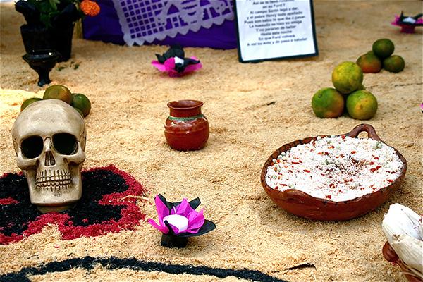 SKULL AND RICE decorate Dia de los Muertos festival in Mexico City. (Photo: Alejandro De la Cruz)