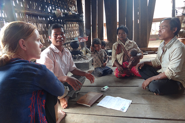 CORNELL PHD candidate Alice Beban (left) used her ARFUSA travel grant to enhance her field research in Cambodia. Here, she interviews a Cambodian farm family about their land security. (Photo: Alice Beban)