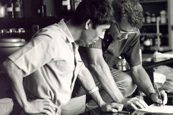 """AKIRA TANAKA (left), head of IRRI's Plant Physiology Department (1962-66), confers with the Institute's first breeder Peter Jennings during the early 1960s. Dr. Tanaka contributed to the development of IR8, the """"miracle"""" variety that jump started the Green Revolution in rice. (Photo: IRRI)"""