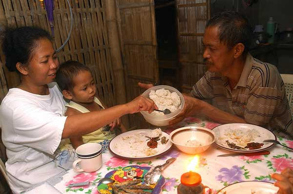 Filipinos eat an average of 123 kg of rice per person every year; for them a meal isn't a meal without rice.  (Photo: IRRI)