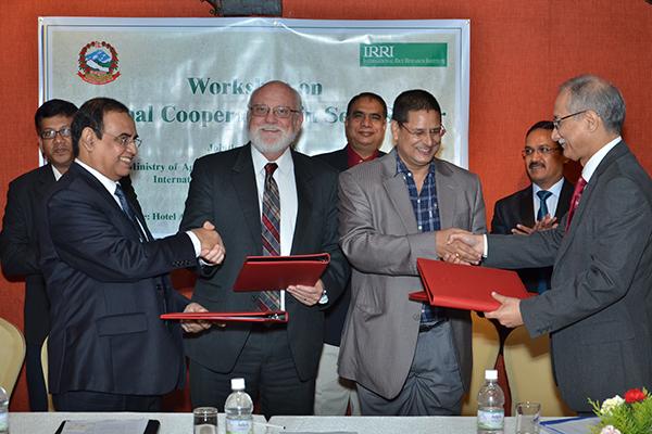 INDIA, BANGLADESH, Nepal, and IRRI seal the deal. From left, S.M. Nazmul Islam, Bangladesh; Robert Zeigler, IRRI director general; Jaya Mukunda Khanal, Nepal; and Ashish Bahuguna, India. (Photo: STRASA-Bangladesh)