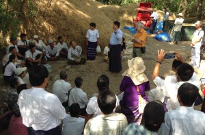 Dr. Myo Aung Kyaw (center, standing), IRRI consultant, explains to farmers how the flatbed dryer works. Dr. Kyaw also spearheaded the training of dryer operators to ensure proper use and maintenance. Photo by Chris Cabardo.