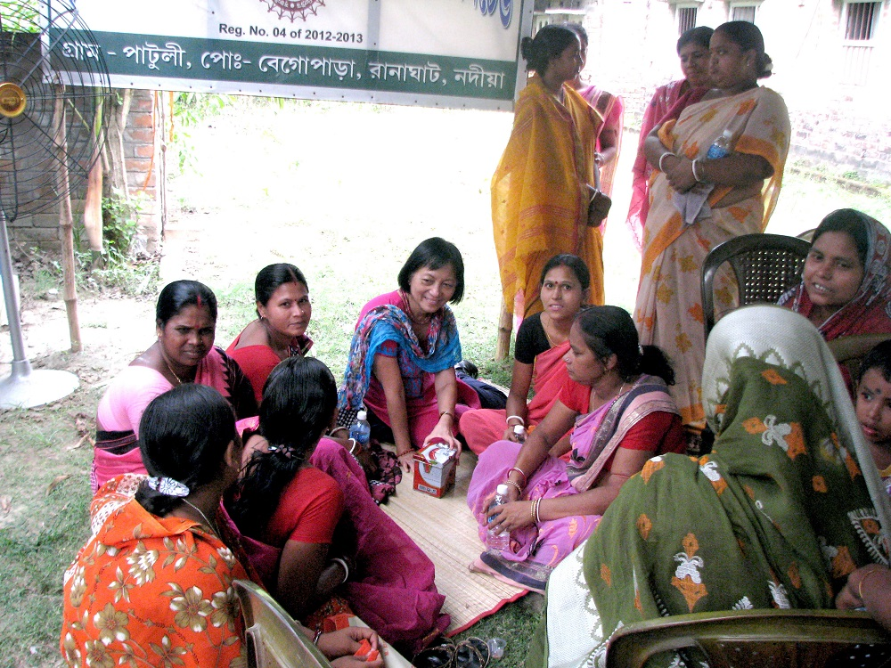 Thelma Paris (center) interacts with women's groups in Patuli Village, Nadia District, Chinsurah, India. (Photo: GRiSP)