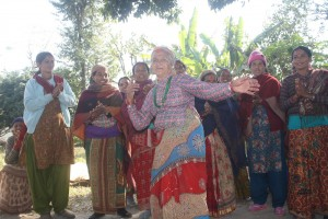 An elderly woman from the Mahjuwa Ladies Seed Producers Group welcomes visitors from the Consortium for Unfavorable Rice Environments and the Institute of Agriculture and Animal Science. (Photo: GRiSP)