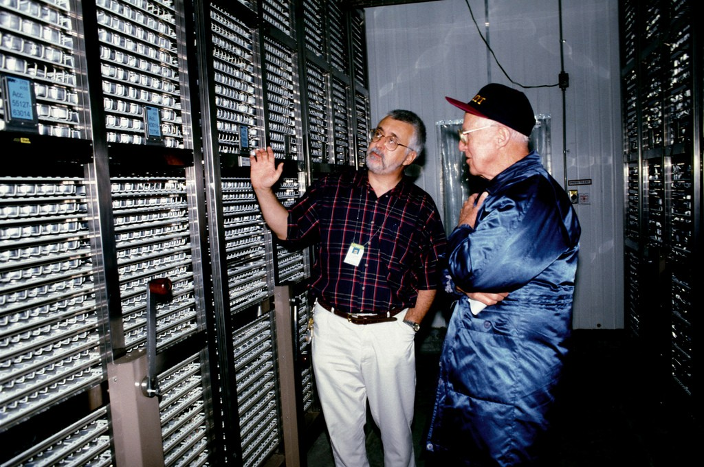 Oblivious to the cold, Dr. Jackson takes Nobel Tourist-Laureate Norman Borlaug on a walkthrough of the genebank's large freezer during his 1999 visit to the Institute. (Photo: IRRI)