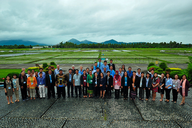 Strong collaboration and synergized efforts are key to more effective implementation of CURE initiatives. Workshop participants pose against the backdrop of IRRI's rice field experiments.