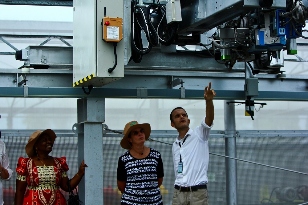 IRRI scientist Dr. Robert Coe explains the high-resolution phenotyping platform to Drs. Bernadette Ndabikunze (right) and Kaye Basford, both members of the IRRI Board of Trustees. Equipped with multiple cameras and sensors, the high-resolution phenotyping platform collects plant growth, performance, and composition data as it sweeps over the rice canopy. It provides scientists the ability to collect unprecedented amounts of information from a single experiment. (Photo by Isagani Serrano.)