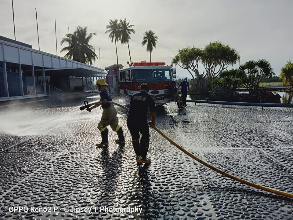IRRI firefighters wash off ashfall from Taal that covered IRRI HQ. Although volcanic ash may cause devastating property damage and loss of life, it is rich in potassium, iron, magnesium, sodium, and calcium. Volcanic eruptions are part of the process that eventually creates the most fertile soil in the world. (Photo: © Jipsey Tandang)