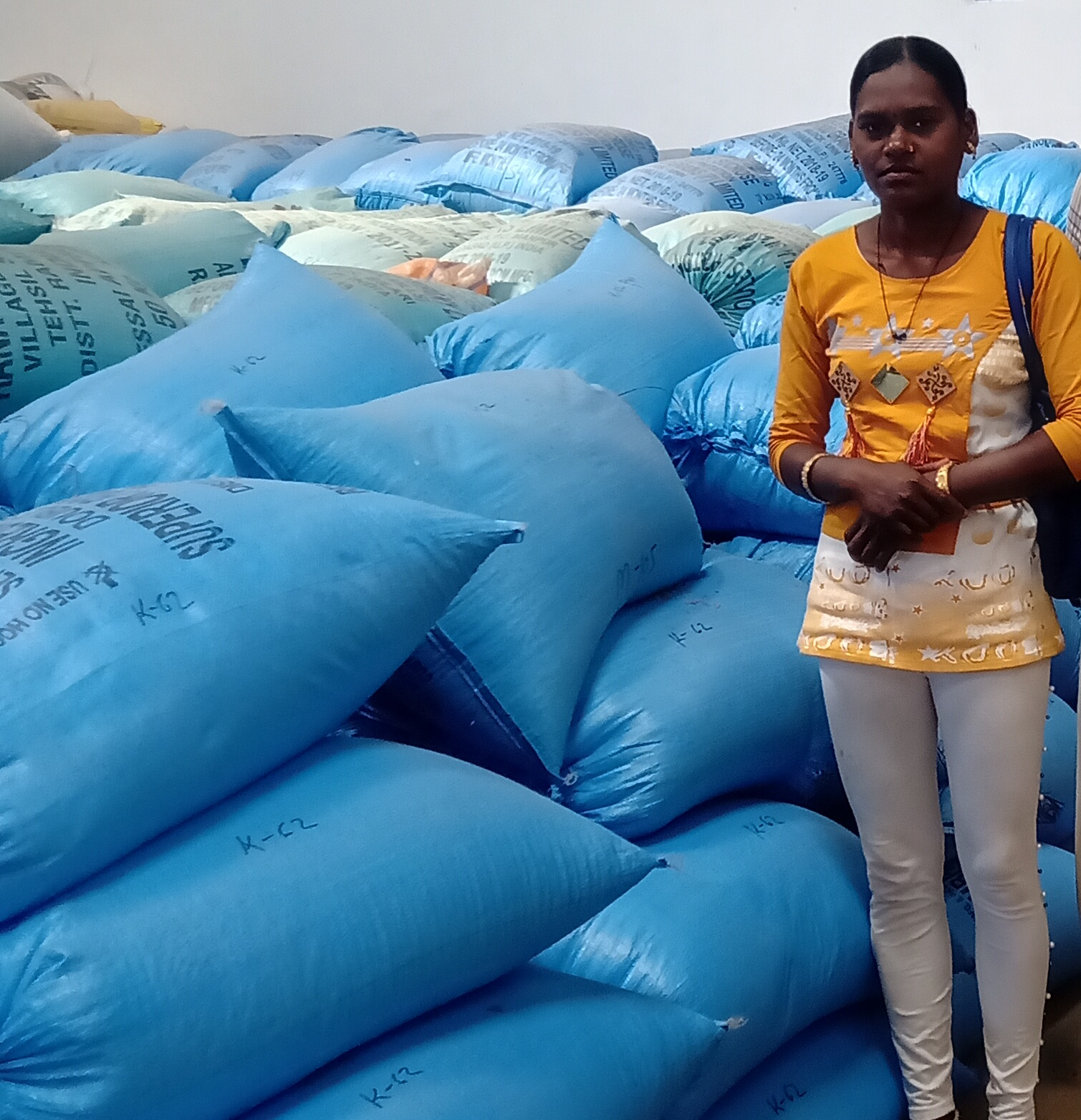 An FPC member with packed paddy seed ready for the market. (Photo: IRRI India)