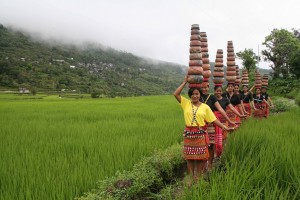 """""""Ullalim"""" harvest festival in Lubuagan, Kalinga as young ladies balance pots re-enacting in a dance how they fetch drinking water in the past."""