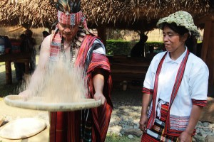 Winnowing rice clad in their colorful Kankanaey attire during a harvest festival in Tadian, Mt.Province.